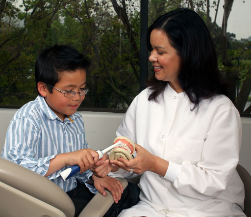 Dr Sablan with a Child patient